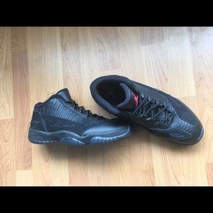 Jordan 11's low referee edition black-black red.